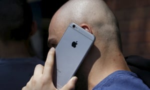 man talking on iPhone