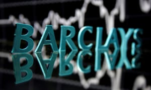 The Barclays logo is seen in front of displayed stock graph