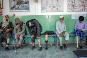 A Taliban member tries on his new prosthetic leg at the Red Cross rehabilitation centre in Kabul