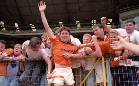 Blackpool fans try to touch the hem of David Eyres' garment after their win over Scunthorpe in the 1992 final.