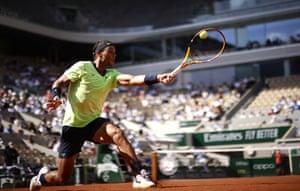 Rafael Nadal stretches for a backhand return against Diego Schwartzman.