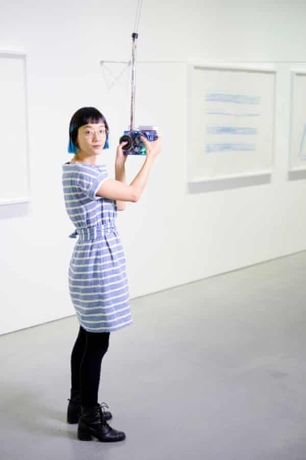 Christine Sun Kim with one of the interactive handsets at her exhibition.