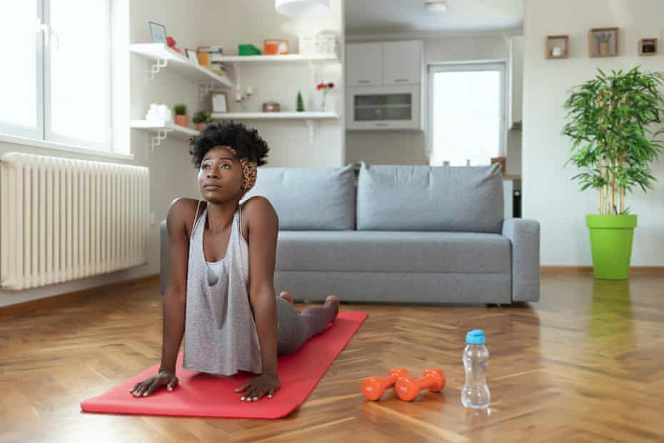 'Try new things you can do quietly at home, such as yoga.' (Posed by model.)
