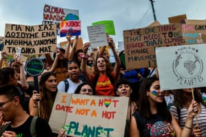 Protesters in Greece. One placard reads: 'I want a hot date, not a hot planet'