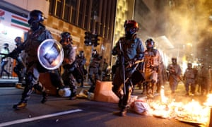 Police passed a burning barricade to break up anti-government protesters in Hong Kong on November 2, 2019.