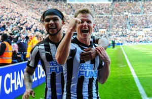 Newcastle's Matt Ritchie celebrates with teammate DeAndre Yedlin scoring their second goal to beat Arsenal 2-1 at St.James' Park.