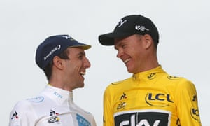 Chris Froome, right, sizes up Simon Yates on the podium after the Tour de France ended in Paris.