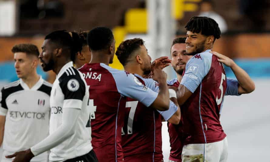 Tyrone Mings (right) celebrates after scoring Aston Villa's third goal against Fulham at Craven Cottage.