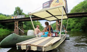 A floating bar serves a passing canoeist.
