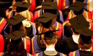 Rear shot of university graduates in cap and gowns.