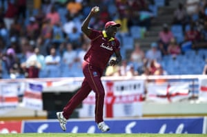 Carlos Brathwaite of the West Indies celebrates catching out Chris Woakes of England.