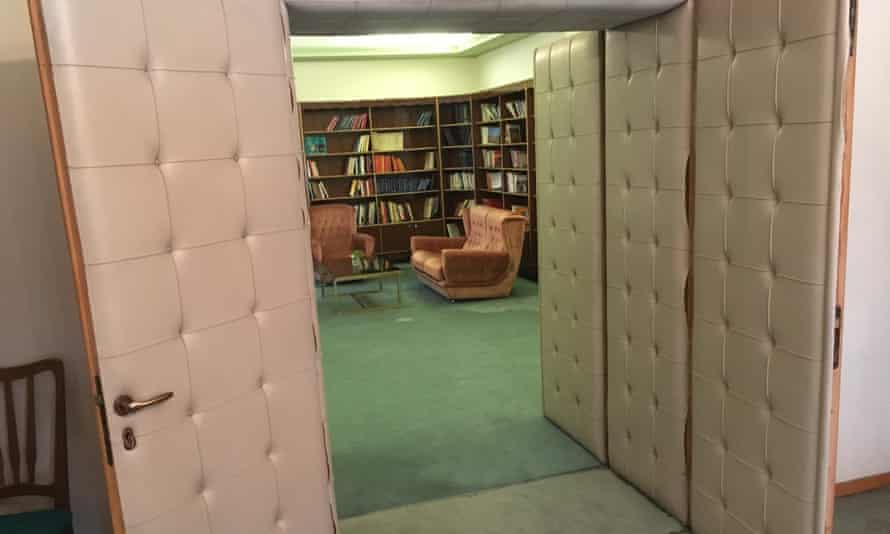 Soundproofed padded doors lead to Hoxha's bedroom.