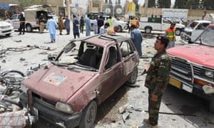Pakistani security personnel gather at the site of a suicide attack near a polling station in Quetta on election day