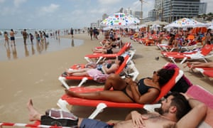 Beachgoers in Tel Aviv