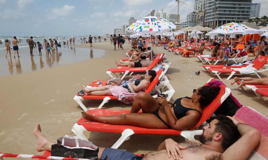 Beachgoers in Tel Aviv