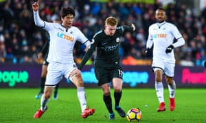 Man City star Kevin De Bruyne (centre) during their recent victory over Swansea City.