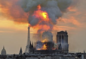 Flames and smoke rise from the blaze at Notre Dame cathedral.