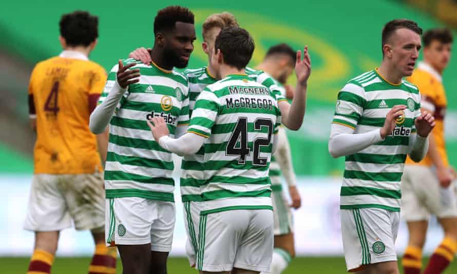 Odsonne Édouard celebrates scoring Celtic's second goal against Motherwell with Callum McGregor.