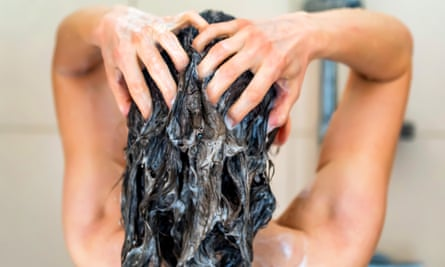 A woman washing her hair in a shower