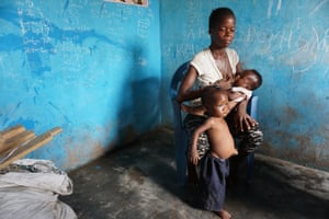 Rebecca, 17, with her two children in Nyanyano. Her children are malnourished and frequently ill