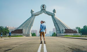 YouTuber Louis Cole in front of the Arch of Reunification in North Korea.