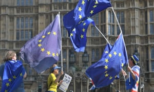 Activists wave European Union and Union flags outside the Houses of Parliament in Westminster, London, May 2018.