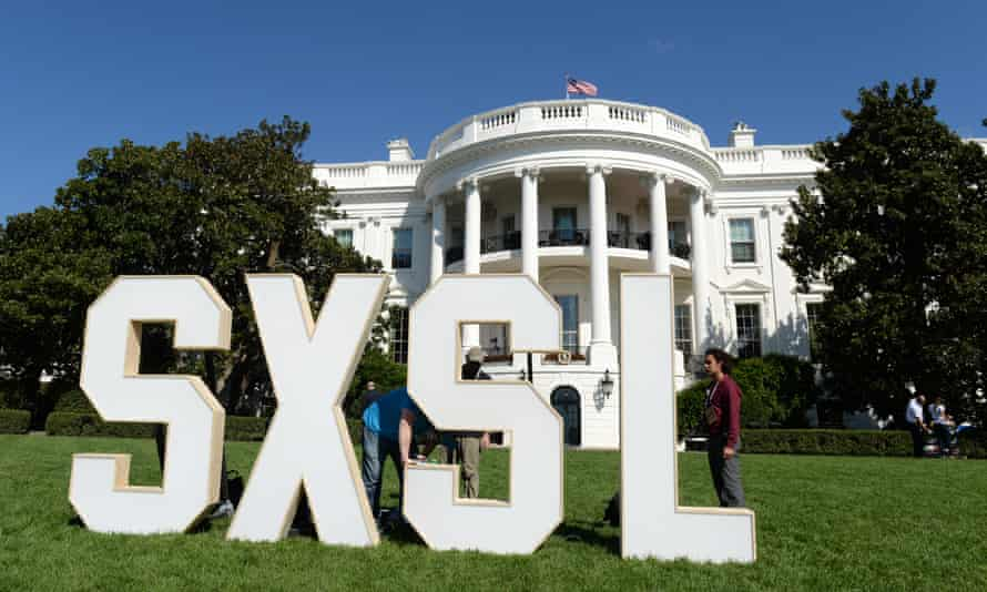 The South By South Lawn logo rests on the South Lawn of the White House in Washington DC on Monday.