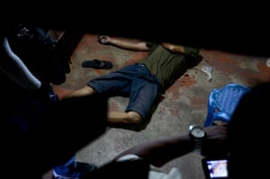 The body of a victim lies on the ground after a drug raid by police in Cebu city,