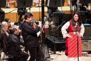 Dessislava Stefanova, right, with Georgi Andreev on gadulka and members of the Philharmonia Orchestra at the Barbican.