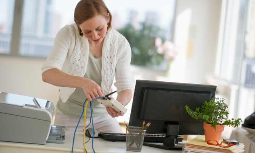 woman installing router at home office