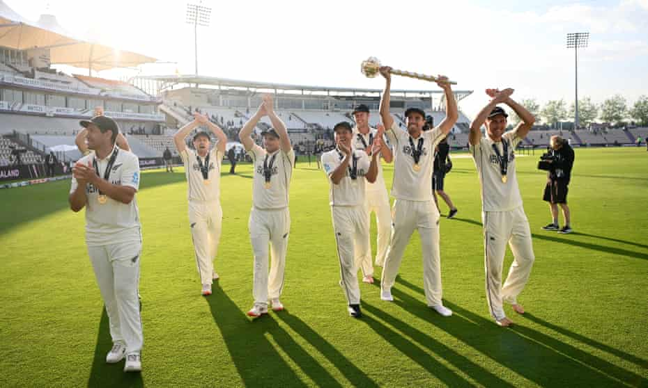 New Zealand players celebrate with the trophy after their gripping win at the Rose Bowl