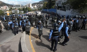 Security forces take positions to block demonstrators during a protest against the re-election of Honduras' President Juan Orlando Hernández in Tegucigalpa on Tuesday.
