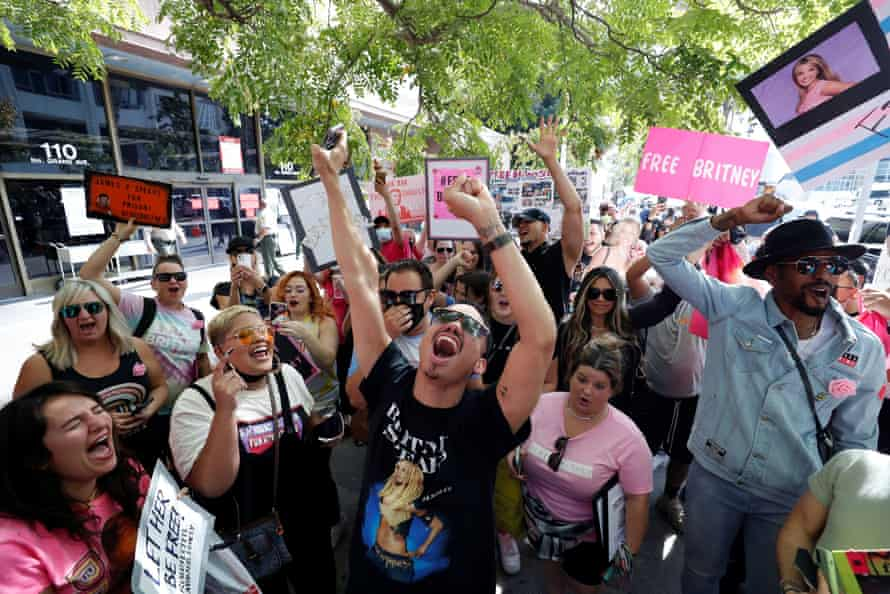 Britney Spears supporters celebrate after a judge suspended her father from guardianship.