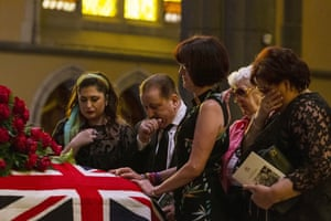 People pay their respects during the state funeral for Sisto Malaspina.