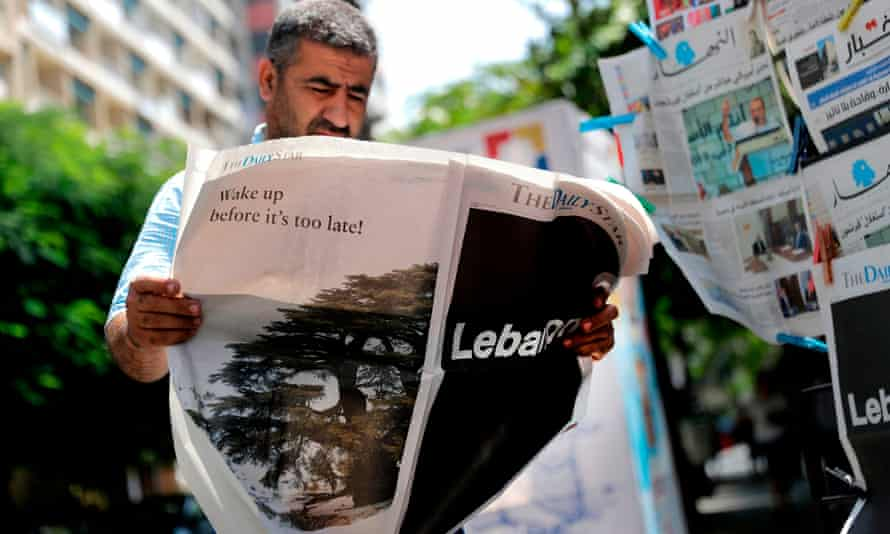 A man reading the Lebanese English-language newspaper the Daily Star in August 2019