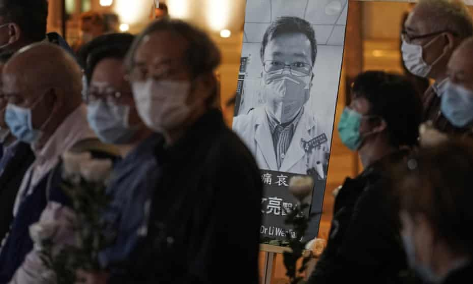 People attend a vigil for Chinese doctor and whistleblower Li Wenliang, in Hong Kong, on 7 February.