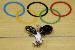 Martha Bayona Pineda of Colombia falls during the second round of the women's keirin.
