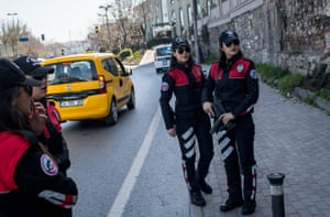 Istanbul, TurkeyPolice officers from Istanbul's Motorcycled Police Unit wait to search vehicles during a roadside checkpoint operation. The rapid response unit nicknamed Dolphins is used primarily in crime prevention operations and has 25 female officers. 6% of Turkey's 250,000 strong police force are women