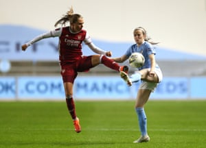 Noelle Maritz of Arsenal battles for possession with Rose Lavelle of Manchester City.