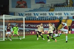 Conor Hourihane of Aston Villa shoots but his effort is deflected away.