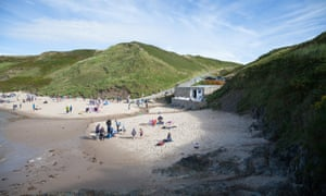 A busy summer day at Whistling Sands Porth Oer