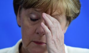German Chancellor Angela Merkel reacts during a press conference