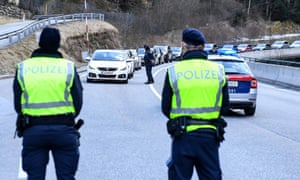Austrian police officers block a road into Paznaun valley, after the government announced a coronavirus quarantine of the Paznaun valley.