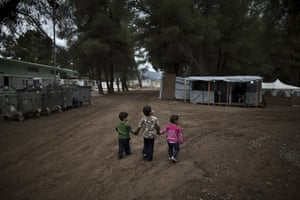 Syrian refugee children hold hands in the refugee camp of Ritsona.