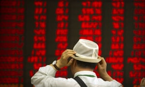 Hold onto your hat! A Chinese investor watches stocks rally in Beijing today.