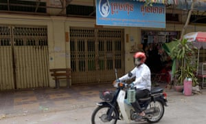 A man on a motorbike past the offices of Ambrosia Labs in Phnom Penh.