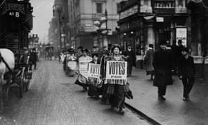 Protesters carrying 'Votes for women' sandwich boards in 1912