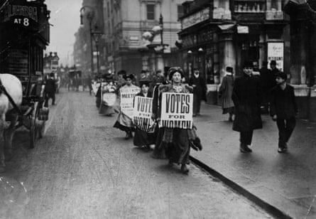 Women advertsing a suffragettes meeting.