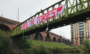 The 'Hang the Tories' banner pictured on the bridge in Salford, along with hanging effigies. All were removed by police.