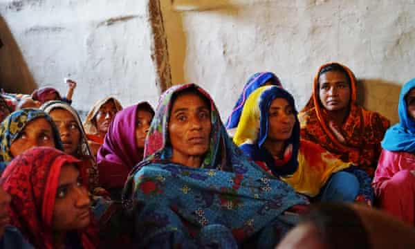 A group of women in Asoo Babar village learn about birth control in a Marvi worker's home.
